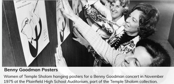 Women of Temple Sholom hanging posters for a Benny Goodman concert in November 1975 at the Plainfield High School Auditorium.